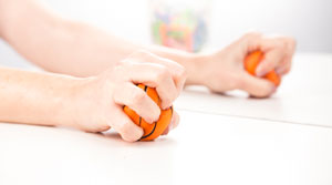 Pair of hands squeezing stress balls